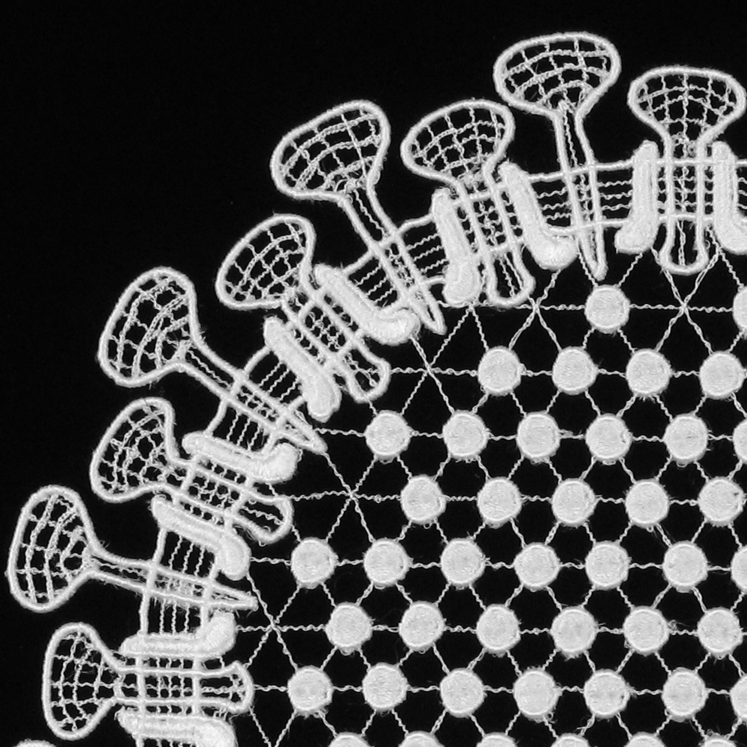 image of a black background with white crocheted design
