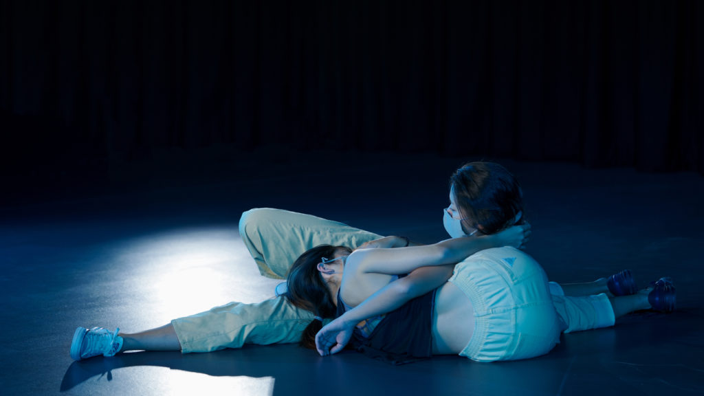 image from Avatar film, of two women embracing each other