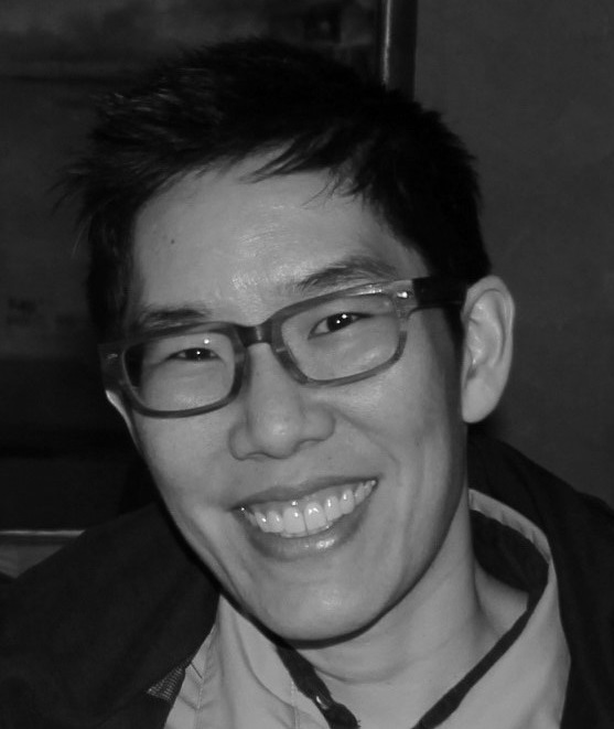 Picture of short-haired, glasses wearing Professor