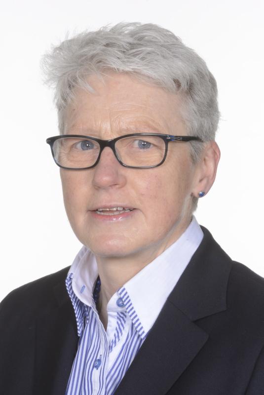 portrait of short, white-haired, glasses wearing Professor