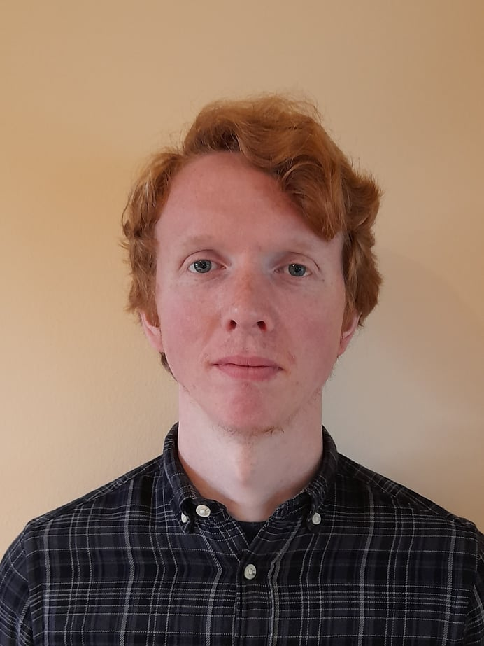 portrait of young male with short red hair