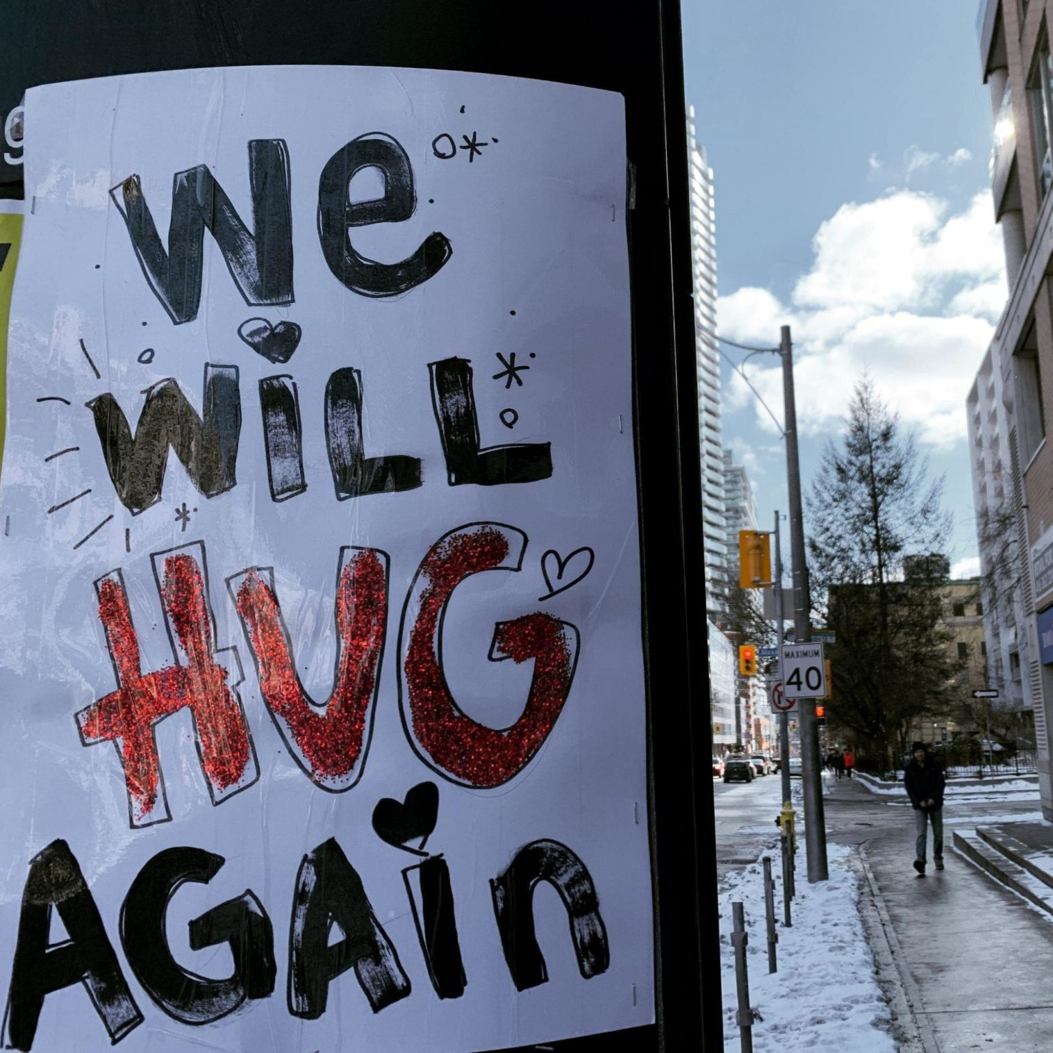picture of a poster that reads 'we will hug again'