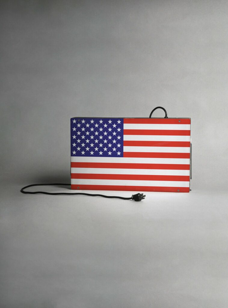 Image of a lamp in the shape and colours of the American flag, unplugged